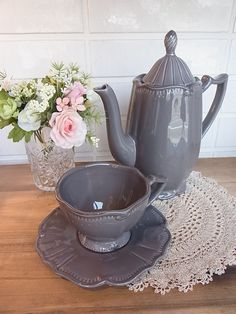 Love the color of this tea pot, cup & saucer.