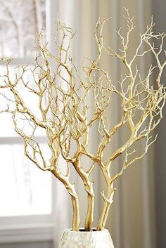 Metallic Gold Branch You'd be surprised at how a little attention to detail can have a big impact on the whole room. Add these Pier 1 Metallic Gold Branches to a vase, lay them on a shelf or lean them against a wall and watch the glam factor go way up! Decoration Branches, Vase With Branches, Tree Branch Decor, Branch Art, Tree Branches, Painted Branches, Wedding Decorations, Christmas Decorations, Table Decorations