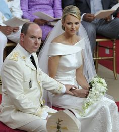 Prince Albert II of Monaco (L) reaches out for Princess Charlene's hand during their religious wedding ceremony at the Palace in Monaco July 2, 2011. REUTERS/Bruno Bebert/Pool