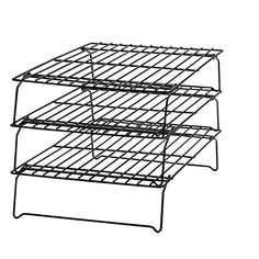Expandable/stackable cooling racks save space and alleviate the struggles of waiting for your desserts to cool. | 26 Essential Products Everyone Who Loves To Bake Should Own