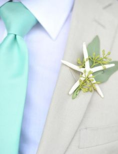 Starfish and seeded eucalyptus boutonniere. Great for a beachy wedding.
