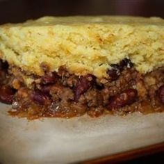 Slow Cooker Tamale Pie | Brown some ground beef and place it into a slow cooker with beans and seasonings, then spoon some corn bread mix topping over the beef, set the cooker, and come home to a tamale pie dinner.