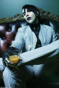 "Marilyn Manson. For such a ""scary"" guy, he's an absolute intellect. Gah! I'd love to sit down to have a real conversation with him."