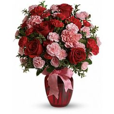 There is a special someone at the top of your dance card, who brings laughter and joy to your #heart every day. Show them how much you care with a Dance with Me #flower bouquet of #carnations and #roses in pretty shades of red and #pink.