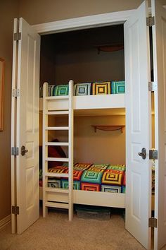 closet beds, great idea! Separate doors, to give child privacy. Sliding into wall?or up in ceiling of top bunk, and the under side of top bunk for bottom bunk.