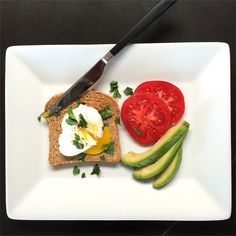 Start the morning with a healthy and energizing breakfast - grainy toast topped with a poached egg and a light dusting of herbs. She paired the toast with slices of tomato and avocado. Courtesy of Jenn Aniston