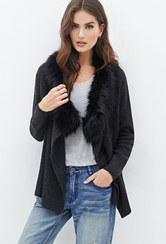 Keep cozy while adding a touch of sophistication to your winter look with a fur collar cardigan.