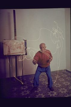 1949: Picasso Paints in Light - Picasso attempting to draw a Minotaur with a light pen.
