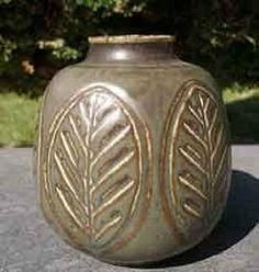 Stoneware vase designed by Gerd Bogelund (b. 1923) for Royal Copenhagen, Denmark. Decorated with leaf pattern.