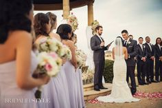 A beautiful photo of the ceremony while the bride and groom exchange their vows. Wedding Planner: Aisle Be With You, LLC | Photography: Photos by Keshia | Venue: Gaillardia Country Club | Florist: Tony Foss Flowers www.tonyfossflowers.com
