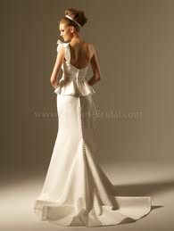 Love peplem look on this wedding dress