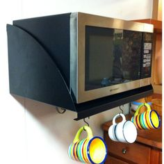 Now you can EASILY mount your microwave and get it off your counter! (Also works for toaster ovens, coffee stations, plates, cookbooks or just extra shelf space!) http://www.frigodesign.com/home-essentials/microwaveshelf.html