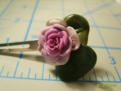 Handmade polymer clay flower on hair clip by HoniBeeHandiCrafts