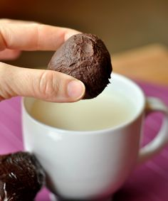 Truffle Hot Chocolate Balls 2c choco chips  1c heavy cream 1tbsp sugar optional 1/8 teaspoon salt Put all ingredients in bowl Micro 1min intervals til silky Careful of overheat Stir often Cool 10 min Cover with plastic Put in fridge 2-3hr. Scoop 1/4c for ea on wax paper Place in fridge 15-20 min Make balls Cover Store in freezer Add to hot choco
