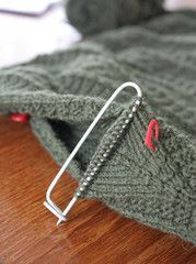 Underarm gusset stitches on the stitch holder. I'd never seen this method until I started doing a bit of research about Gansey knitting. I bet they're more comfortable and flexible than a regular seam.: