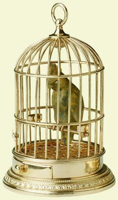 Cockatoo in a gold cage by Faberge