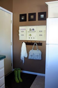 Entry way - love the taupe color of the wall too.
