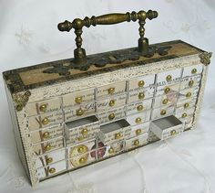 "Match box cabinet, for storing small things. I suppose the ""structure"" is an old drawer. Lovely."