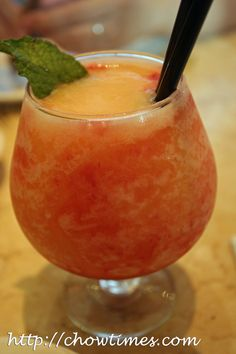 Georgia Peach, Favorite drink 2 ounces vodka (Skyy recommended) 1 ounce peach liqueur ½ cup peach slices (fresh or frozen) ½ cup crushed ice ¼ cup red raspberries (fresh or frozen) fresh mint , to garnish. 1. Combine the vodka, peach liqueur, peaches, and ice in a blender.2. Blend until smooth. 3. Add the raspberries and blend briefly, until berries are broken but not completely blended in to the drink. 4. Pour into two balloon glasses and garnish with fresh mint.