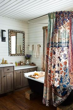 Bathroom with colourful Anthropologie Risa Shower Curtain