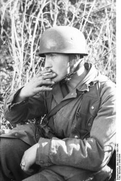 Nettuno, Italy. German paratrooper (Fallschirmjäger) , smoking a cigarette. 1943.