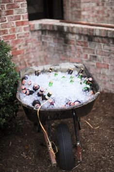 Wheelbarrow for Drinks.  Just saying.. you could move it where ever the party take you!! HAHA My mom has an old rusty wagon.....