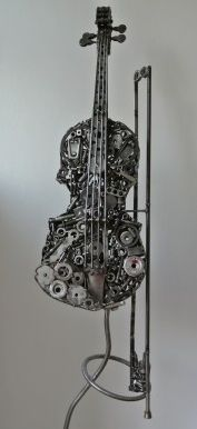 Recycled Art Sculpture: Violin & Bow - This stunning sculpture is by Otis Griffith. The metal sculptures made out of a combination of recycled and new materials.
