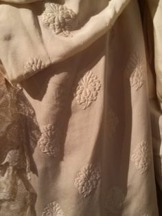 Photo taken 2014: Close up of the ivory embroidered crepe de chine and some of the lace as it gathers toward the top to create the fabric bustle in back. On Julia Wade's 1869 wedding gown at Atwood House Museum, Chatham, MA. #atwoodhouse, #chathamhistoricalsociety, #silk, #lace, #1800s, #1800scostume, #weddinggown, #dress, #chatham, #capecod