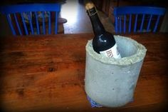I've been experimenting with concrete, so I knew I wanted to use that material for a good sized project to make a statement. For the holidays, the in-laws are getting a concrete wine bucket.