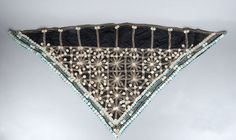 Mfengu (Xhosa) married woman's head scarf with beadwork and mother of pearl buttons.