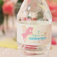 """Add some magic to your Unicorn Party with these adorable Rainbow Unicorn  Water Bottle Labels.  Each label measures 9"""" x 1.35,"""" and fits standard size water bottles.  You will receive one high-resolution PDF that holds 4 printable water  bottle labels, along with full printing & usage instructions.  The files will be available for instant download immediately upon purchase.  No physical items will be delivered.  *Get gorgeous inspiration for this theme by viewing our Unicorn Party here ."""