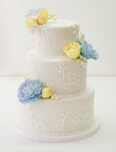 Wedding cake Blue and yellow flowers