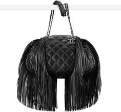 CHANEL Fashion - Drawstring handbag  www.chanel.com   Paris-Dallas 2013/14 Métiers d'Art - Lambskin drawstring bag embellished with fringe
