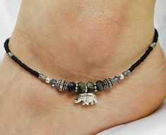 Elephant sterling silver anklet, ankle bracelet made with gemstone beads and sterling silver. Part of my new sterling silver gemstone collection of anklets.  ~ Solid hand-made artisan sterling silver elephant charm ~ African grey opal rondelle beads ~ Artisan sterling silver barrel beads ~ Denim blue Swarovski crystals ~ Matte jet black Czech glass seed beads around sides with larger matching grey and blue Czech glass seed beads ~ Remaining metal beads and lobster claw clasp are sterling…