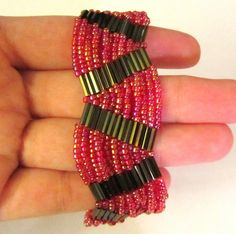 Seed beads bracelet done with silver bugle beads and red seed beads, beaded jewelry, seed beads jewelry, beaded bracelet. Beaded Cuff Bracelet, Seed Bead Bracelets, Seed Bead Jewelry, Beaded Earrings, Beaded Jewelry, Jewelry Bracelets, Handmade Jewelry, Peyote Bracelet, Diamond Bracelets