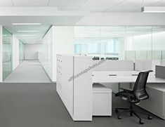 White Office Interior Design by Garcia Tamjidi Interior