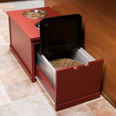 large-dog dining station keeps food neatly contained and conveniently available, and its height allows the canine's head and neck to be at a good angle for swallowing food and water. Swallow Food, Dog Feeding Station, Dog Station, Dog Furniture, Dog Rooms, Dog Food Storage, Dog Feeder, Dog Houses, Diy Stuffed Animals