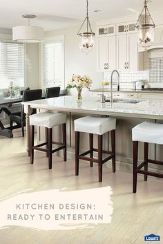 Design a kitchen with entertaining in mind. An expansive island offers a prime work surface for food prep while guests can comfortably mingle and snack.