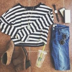 lon sleeve white cop top with black stripes, jeans, brown boots