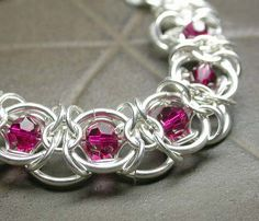 Basket Chain Maille with Ruby Crystals by Simply_Adorning, via Flickr