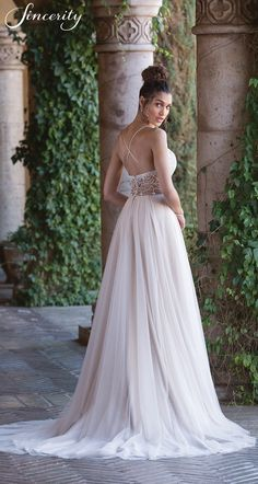 Style 4028: Feel graceful and light in this Jersey and tulle wedding dress. Hand beading accents the sweetheart bodice of the gown paired with a light tulle skirt for effortless movement. Spaghetti straps crisscross the back of the gown to the beaded Illusion square cut back.