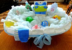 The baby tub gift I made before I wrapped it. I bought a baby tub, put newborn d… The baby tub gift I made before I wrapped it. I bought a baby tub, put newborn diapers around the rim, tied a wide blue ribbon around the tub. Added two baby face cloths ove Baby Bath For Shower, Baby Tub, Baby Shower Parties, Baby Shower Gifts, Baby Gifts, Newborn Diapers, Baby Shower Invitations For Boys, Second Baby, Blue Ribbon