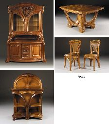 Carved Walnut Dining Suite,  DESIGNED BY EUGÈNE VALLIN, 1902, EXECUTED IN 1903 IN COLLABORATION WITH VICTOR PROUVÉ