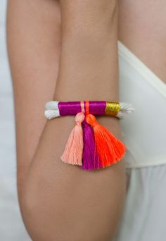 Thread & Tassel Bracelet by Krysos + Chandi. From colors to materials, I love everything about this bracelet. The perfect simple summer accessory. $48