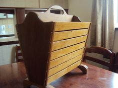 A simple magazine rack made at Elmwood Craft Centre from re-cycled wood