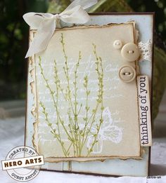 """Hero Materials:  PW110Embossing Powder - White   K5375French Writing With Butterfly   CL342ClearDesign: Everyday Sayings   CL428Earth Flowers   AF155Tim Holtz: Tea Dye Distress Dye Ink Pad   VC250VersaMark Watermark Stamp Pad       Additional Materials:   Antique Linen Distress Ink, patterned paper (""""Village Roadshow"""" by Fancypants), cardstock (dark brown, vanilla), dark brown ink, olive green ink, pale blue ink, buttons, embroidery thread, crochet trim, vanilla seam binding (Stampin' Up)…"""