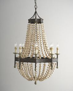 Like this look, but in a scaled down size. Wood Bead Eight-Light Chandelier by Regina-Andrew Design at Horchow.