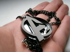 Avengers Necklace , Laser Cut Black and Mirror Avengers Logo  Pendant Necklace - Sale 15 %. $15.25, via Etsy.