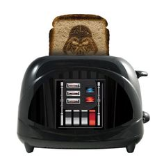 The Star Wars Darth Vader Toaster brings the Force to your breakfast table. This innovative toaster resembles Darth Vader's chest plate and features his helmet toasted into the center of the bread. Cocina Star Wars, Darth Vader Toaster, Pop Up Toaster, Vader Helmet, Star Wars Room, Star Wars Darth, Star Trek, Darth Maul, Polypropylene Plastic