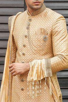 Buy Heavy Embroidered Sherwani perfect for Wedding from the Manyavar Collection. Select from a range of jodhpuri sherwanis, designer sherwani for groom, traditonal, sangeet sherwani & a lot more. Sherwani For Men Wedding, Wedding Dresses Men Indian, Wedding Outfits For Groom, Groom Wedding Dress, Sherwani Groom, Indian Bridal Outfits, Wedding Attire, Indian Men Fashion, Mens Fashion Wear
